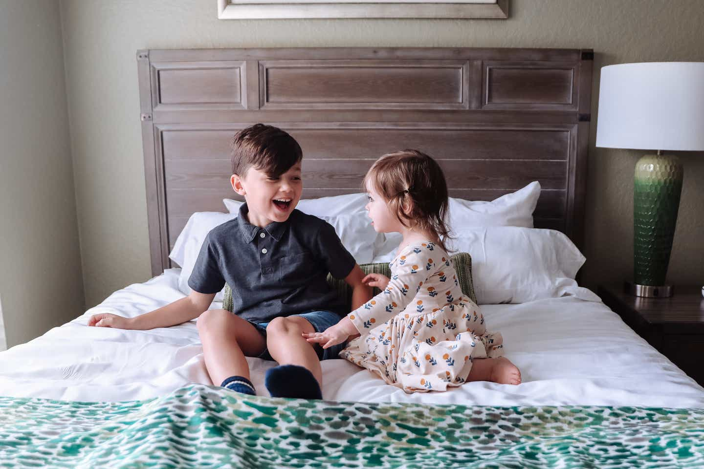 Mia's kids on a bed