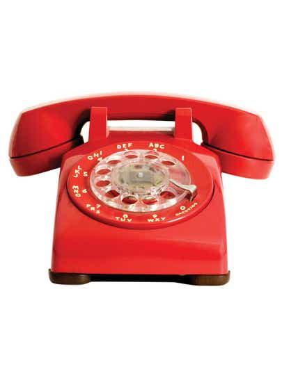 An old red rotary phone