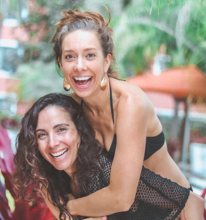 Raff's wife, Micaela, giving her a piggyback ride at Orange Lake Resort.