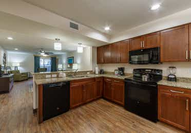 Full kitchen with oven, microwave, sink, dishwasher, and fridge in a one-bedroom villa at Scottsdale Resort