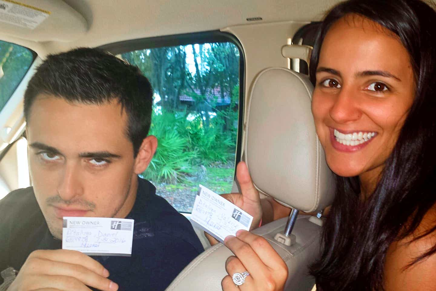 Author, Danny Pitaluga (left), looks quite displeased as he and his wife, Val (right), gives a thumbs up inside their parent's car holding their Holiday Inn Club Vacations Membership Cards.