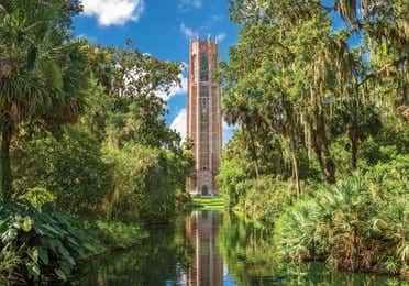 Tall brick building on lake among trees near Orange Lake Resort in Orlando, Florida