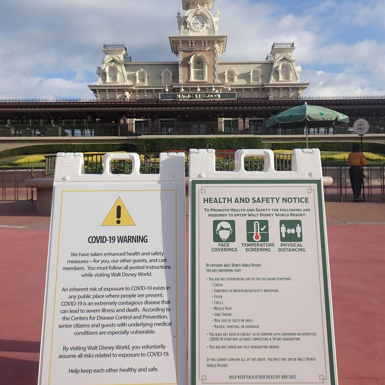 A COVID-19 safety signage at Walt Disney World resort indicating social distancing.
