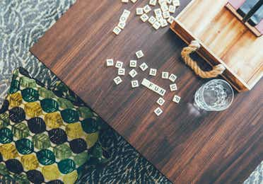 Closeup of coffee table with Scrabble pieces in a villa in River Island at Orange Lake Resort near Orlando, Florida