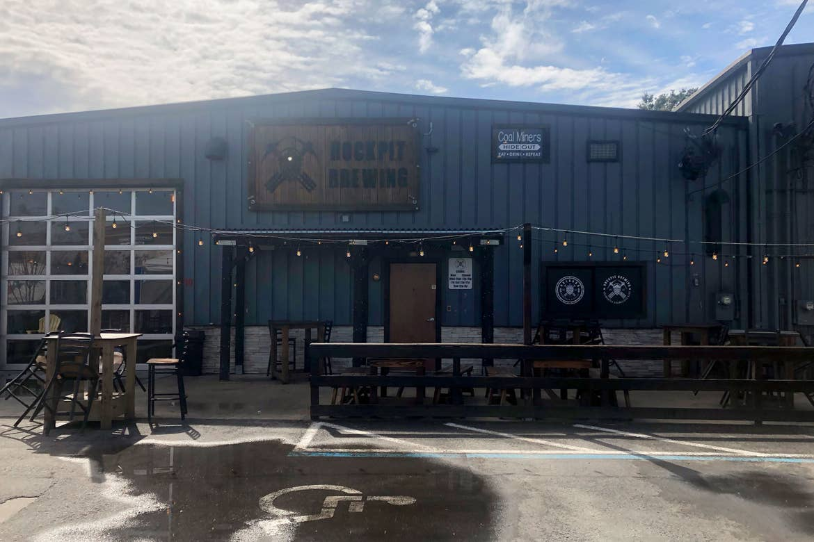 Exterior and outdoor dining space of 'Rockpit Brewing.'