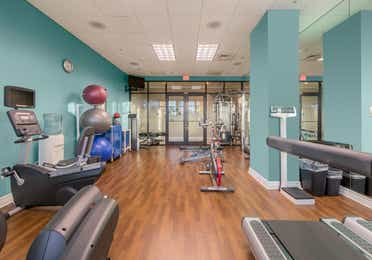 Fitness center with yoga balls, weights, and treadmills at Sunset Cove Resort