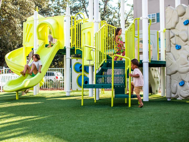Children playing on playground at South Beach Resort in Myrtle Beach, South Carolina.