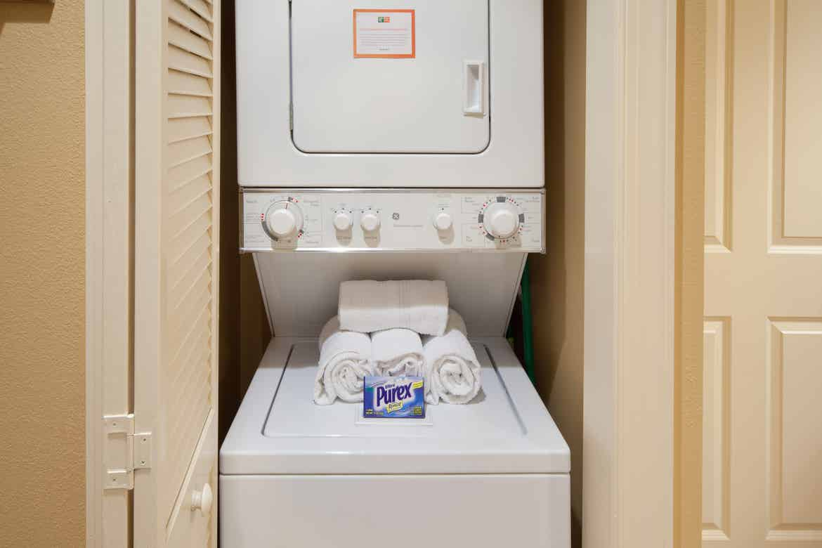 Stacked washer and dryer unit in our two-bedroom villa at Smoky Mountain Resort.