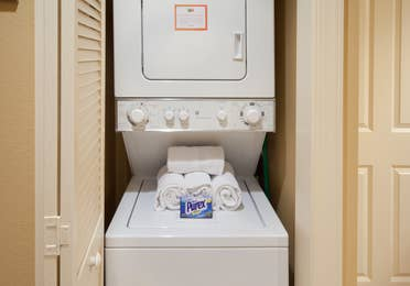 Stacked washer and dryer unit in a villa at Smoky Mountain Resort.