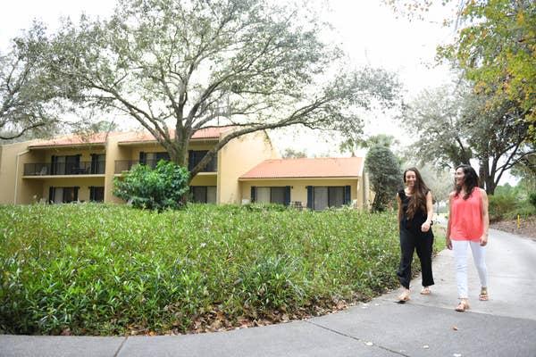 Two women walking around a resort property