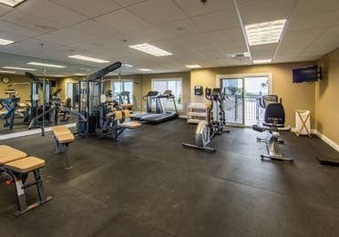 Fitness center with treadmills, ellipticals and stationary bicycles at Galveston Beach Resort in Texas.