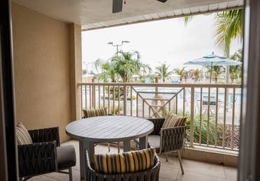 Balcony with pool view in a two-bedroom Signature Collection villa at Cape Canaveral Beach Resort.