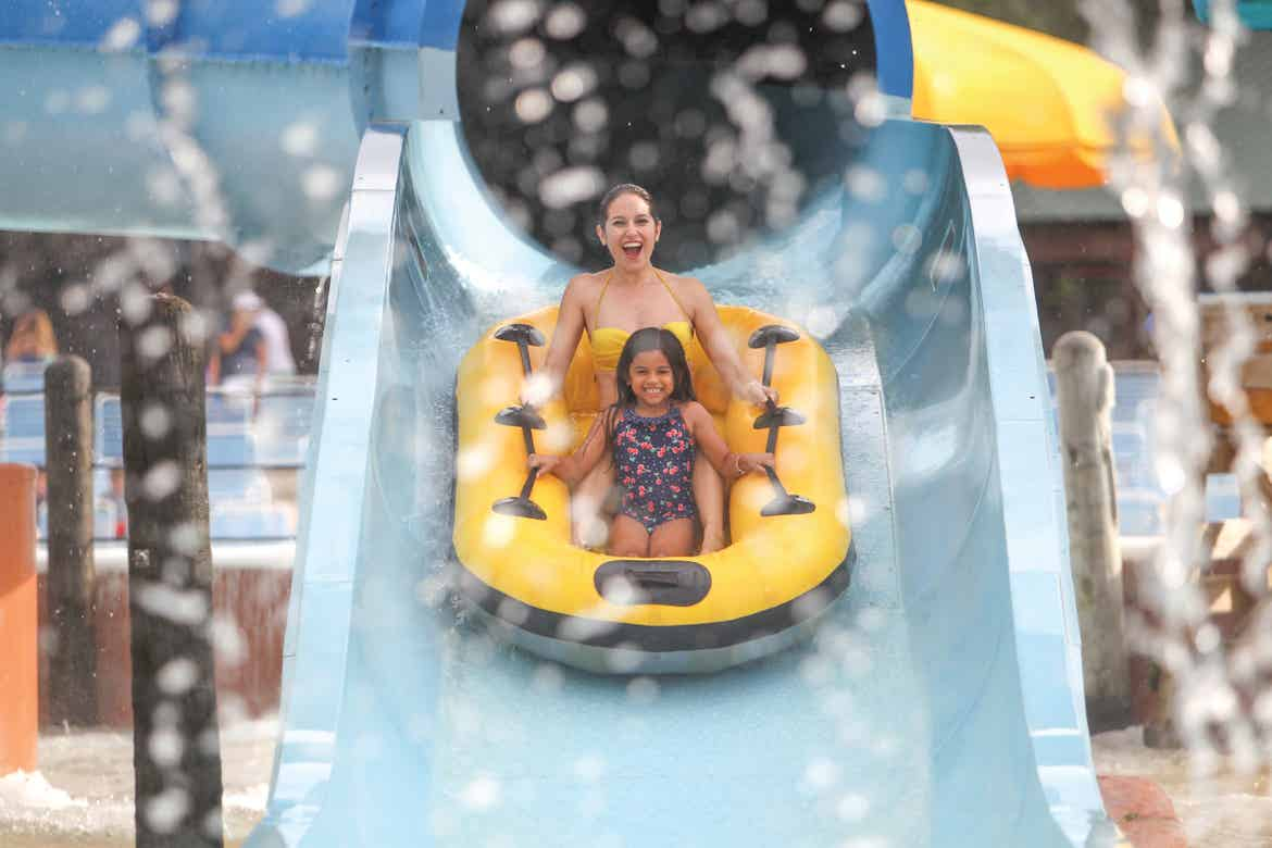 Woman and young girl coming down a waterslide at Schlitterbahn New Braunfels.