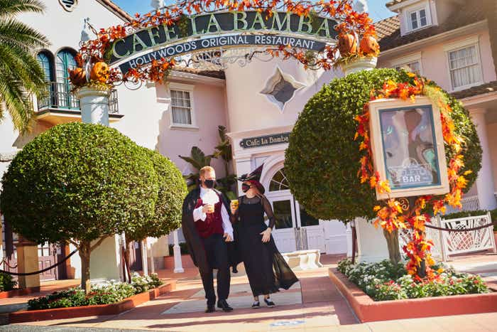 Guests exit Cafe La Bamba in spooky costumes with themed Halloween food and beverage.