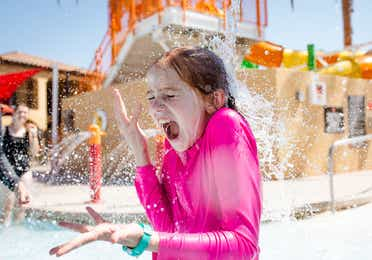 Young child playing at Splash Canyon waterpark at Scottsdale Resort in Scottsdale, Arizona.