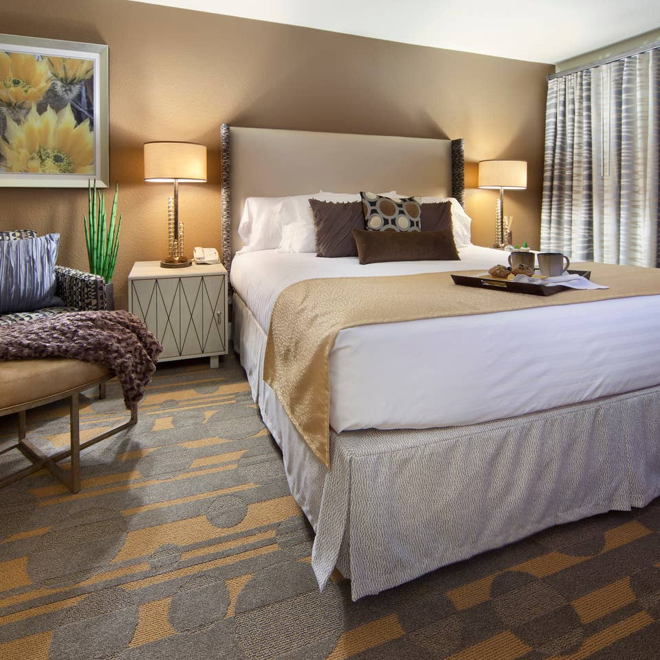 Bedroom in a one-bedroom villa at Desert Club Resort in Las Vegas
