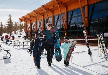Family preparing to ski on Heavenly Mountain near Tahoe Ridge Resort in Stateline, Nevada.