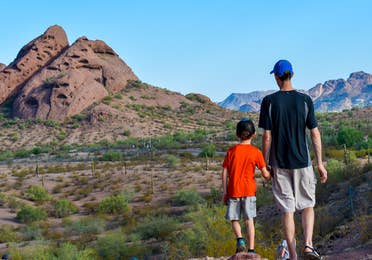 Jessica Averett's husband (right) and son (right) stand looking out at the McDowell Sonoran Preserve in Scottsdale, Arizona.