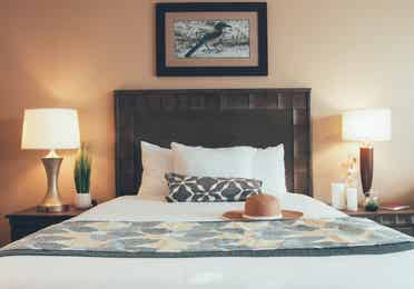 Bed with two night stands in a three bedroom villa in West Village at Orange Lake Resort near Orlando, FL