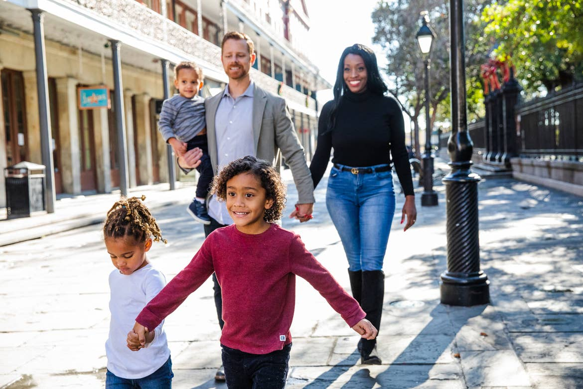 Featured Contributor, Sally Butan of @butanclan (top-right) stands with her husband, Kevin (top-left), and their children walk holding hands down the streets of  of New Orleans, Louisiana.
