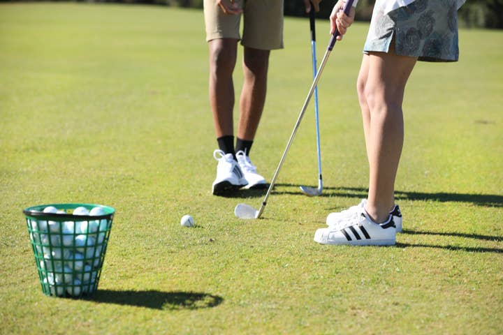 Golfers putting on course at Orange Lake Resort near Orlando, Florida
