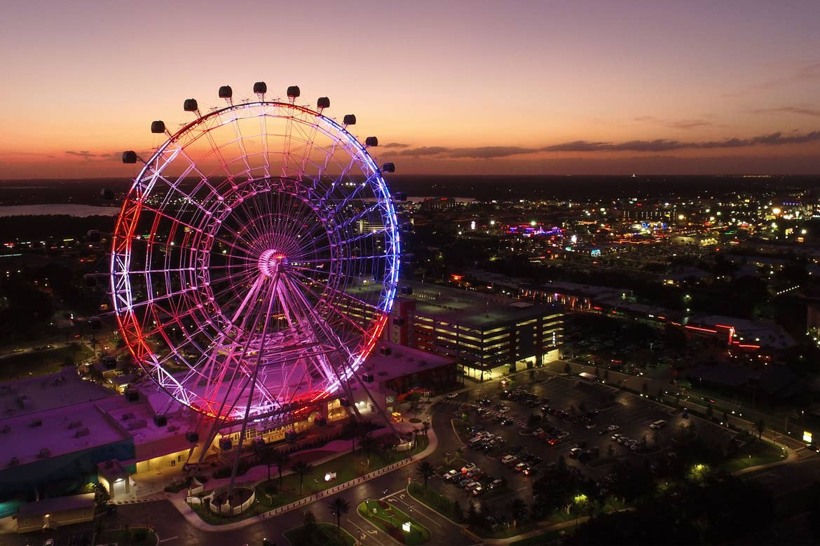 Aerial view of the Orlando Eye lit up at night.