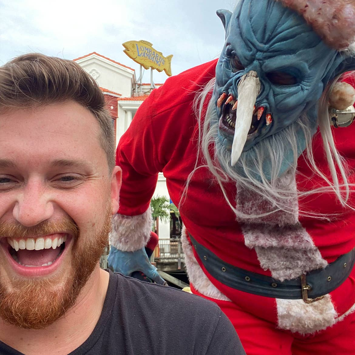 A man is confronted by a 'Demon Santa' performer.