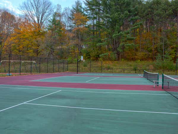 Two outdoor tennis courts at Mount Ascutney Resort in Brownsville, Vermont.