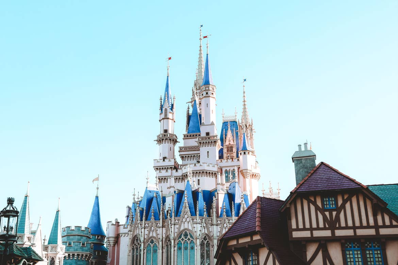 Cinderella's Castle at Magic Kingdom Park at Walt Disney World® Resort under a blue sky.