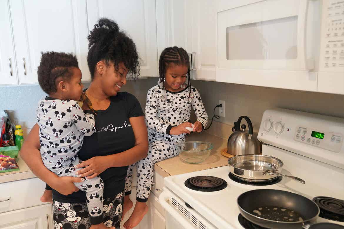 Featured Contributor, Tina Meeks, stands with her daughter and son making breakfast inside of their villa at our Orange Lake resort in Orlando, Florida.