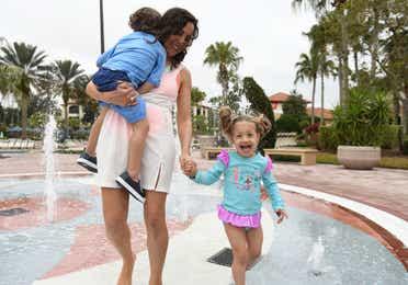 Family walking through splash pad at Orange Lake Resort near Orlando, Florida