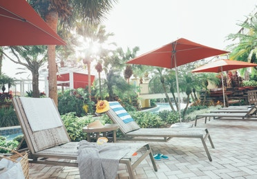 Sun chairs under umbrellas in River Island at Orange Lake Resort near Orlando, Florida