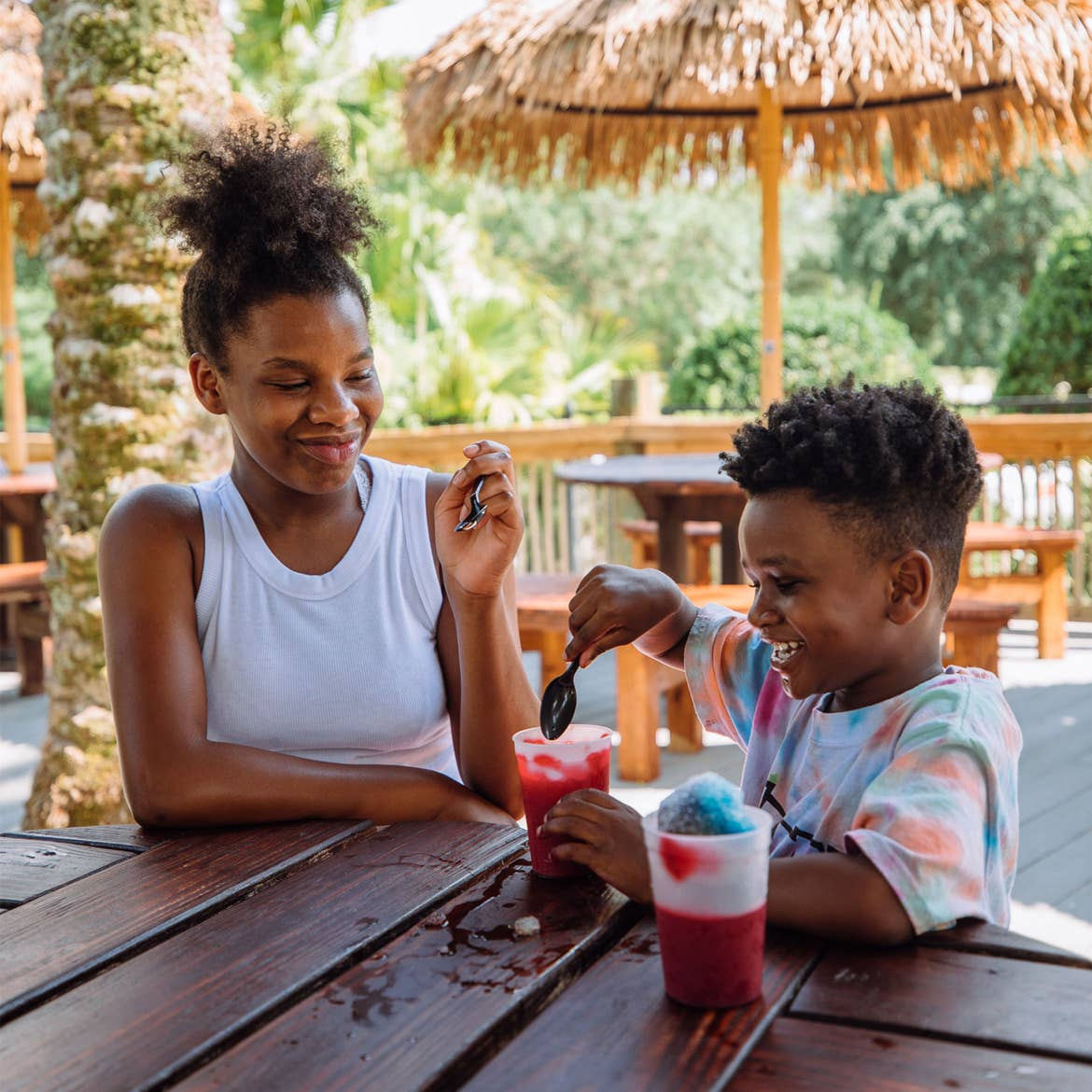Sabria (left) and Joshua Godfrey (right) enjoy snowcones together on the deck of our Orange Lake Resort located in Orlando, FL.