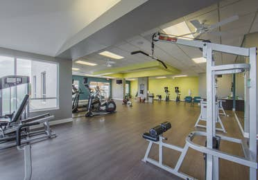 Fitness center with treadmills, elliptical machines, and weight machines at Cape Canaveral Beach Resort