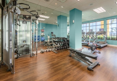 Fitness center with free weights and treadmills at Sunset Cove Resort