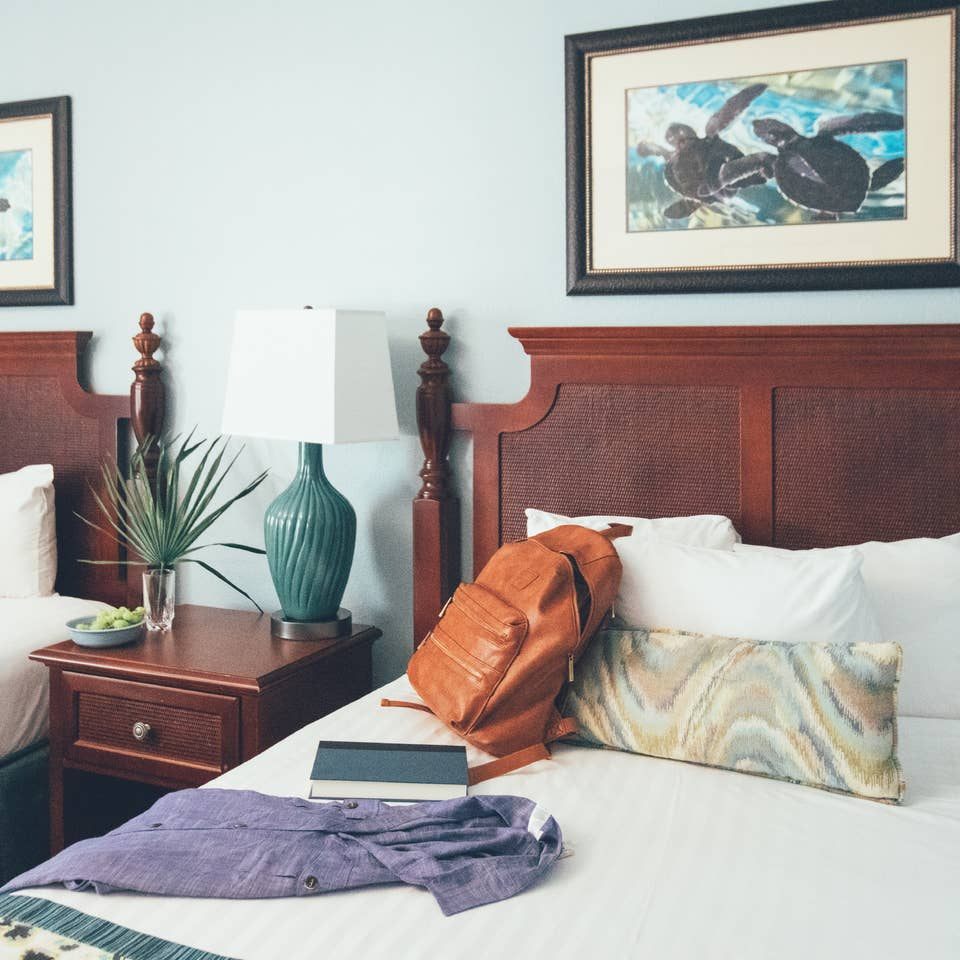Close up of two beds with nightstand in between in a two bedroom villa in West Village at Orange Lake Resort near Orlando, FL