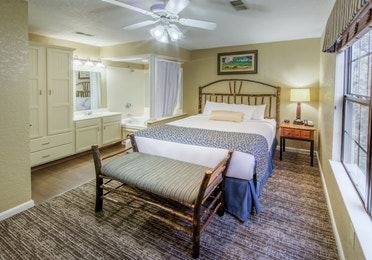 Master bedroom with in-room tub and vanity in a two bedroom villa at Oak n' Spruce Resort in South Lee, Massachusetts