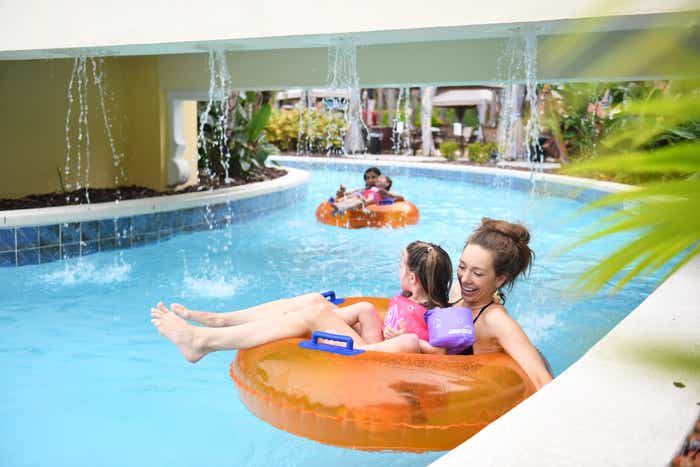 Raff with her daughter floating in the lazy river