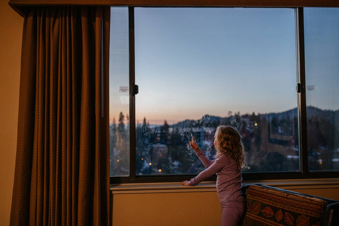 Andrea Rassmussen's daughter looks out their villa window to a starry night sky over the mountain range.