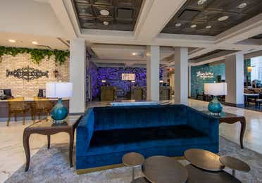 Navy blue couch in lobby of New Orleans Resort in Louisiana.