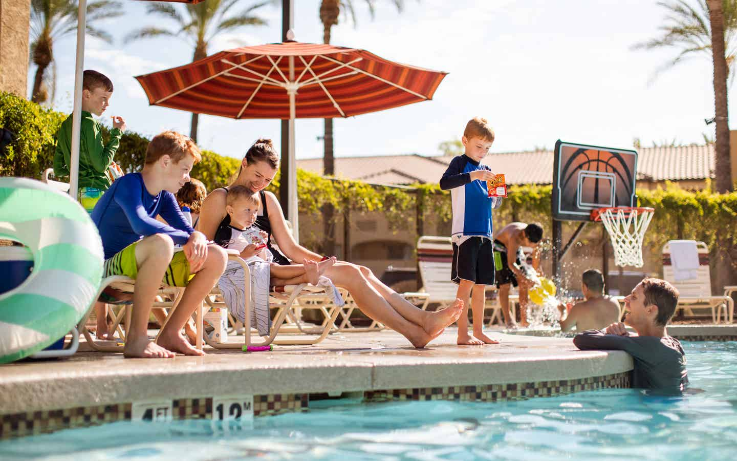 Family by the pool at Scottsdale Resort in Scottsdale, Arizona.