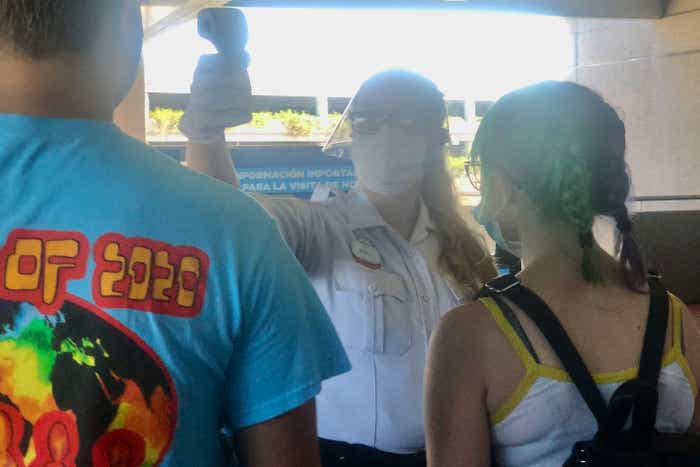 Guests receive their temperature check from a Universal Orlando Team Member prior to park entry.