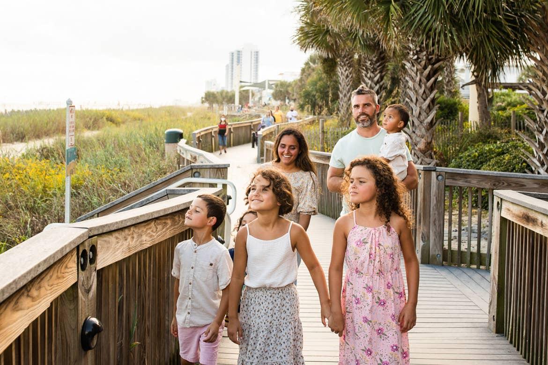 Author, Brenda Rivera Sterns' family walks along the boardwalk near our South Beach Resort in Myrtle Beach, South Carolina.