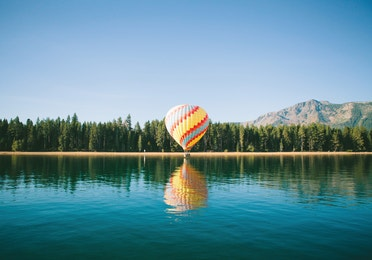 A hot balloon floating over Lake Tahoe