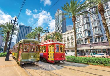 Two New Orleans streetcars in the city.