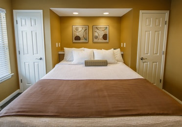 Master bedroom with two closets in a two-bedroom ambassador villa at the Hill Country Resort in Canyon Lake, Texas.