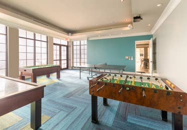 Game room with Foosball table and ping pong table at Sunset Cove Resort