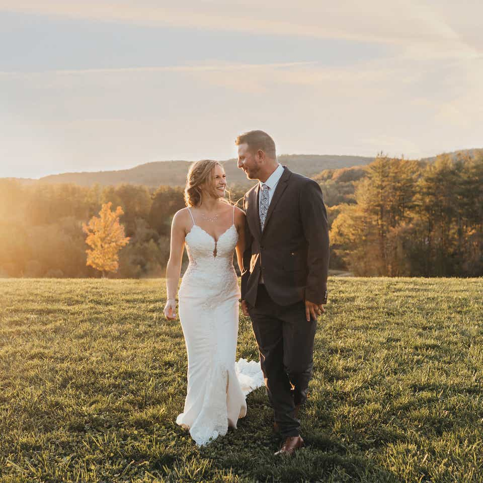 Bride and groom standing on hill after a wedding at Mount Ascutney Resort in Brownsville, Vermont.