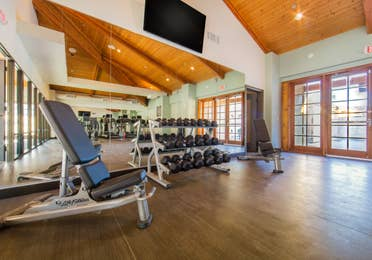 Fitness center with weights and cardio machines at Scottsdale Resort in Arizona