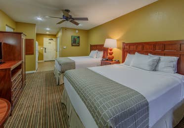 Two queen beds and a flat screen TV in a studio villa at Fox River Resort in Sheridan, Illinois